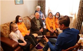 Назаровских ветеранов СУЭК поздравили с Днем защитника Отечества